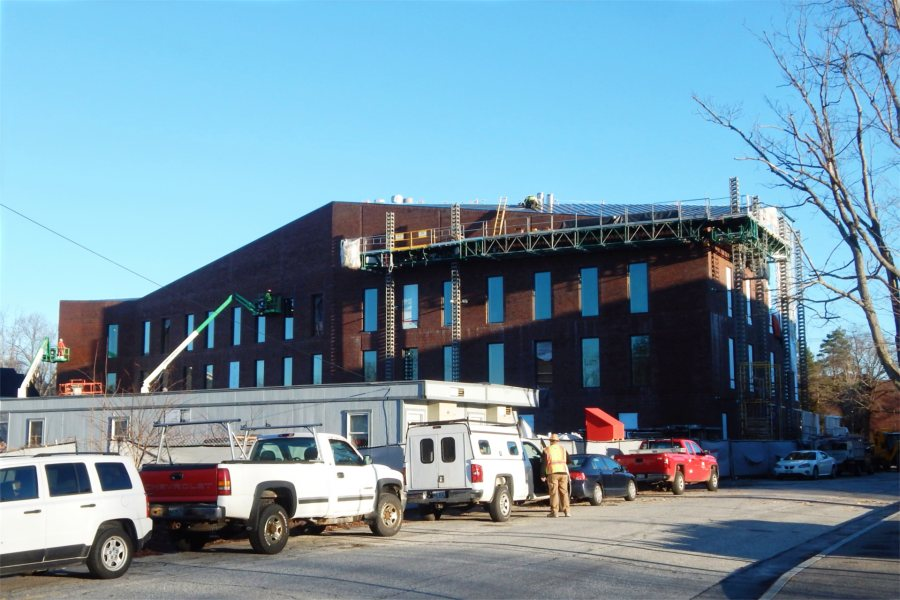Now completely sheathed in brick, the south wall of the Bonney center  is shown early on Dec. 2, 2020. (Doug Hubley/Bates College)