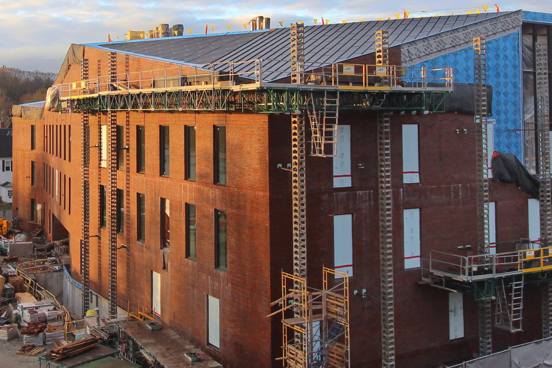 An image taken by a time-lapse camera atop Chu Hall shows new roofing panels, top center, and completed brickwork on the south wall of the Bonney building. (Courtesy of Chris Streifel/Bates College)
