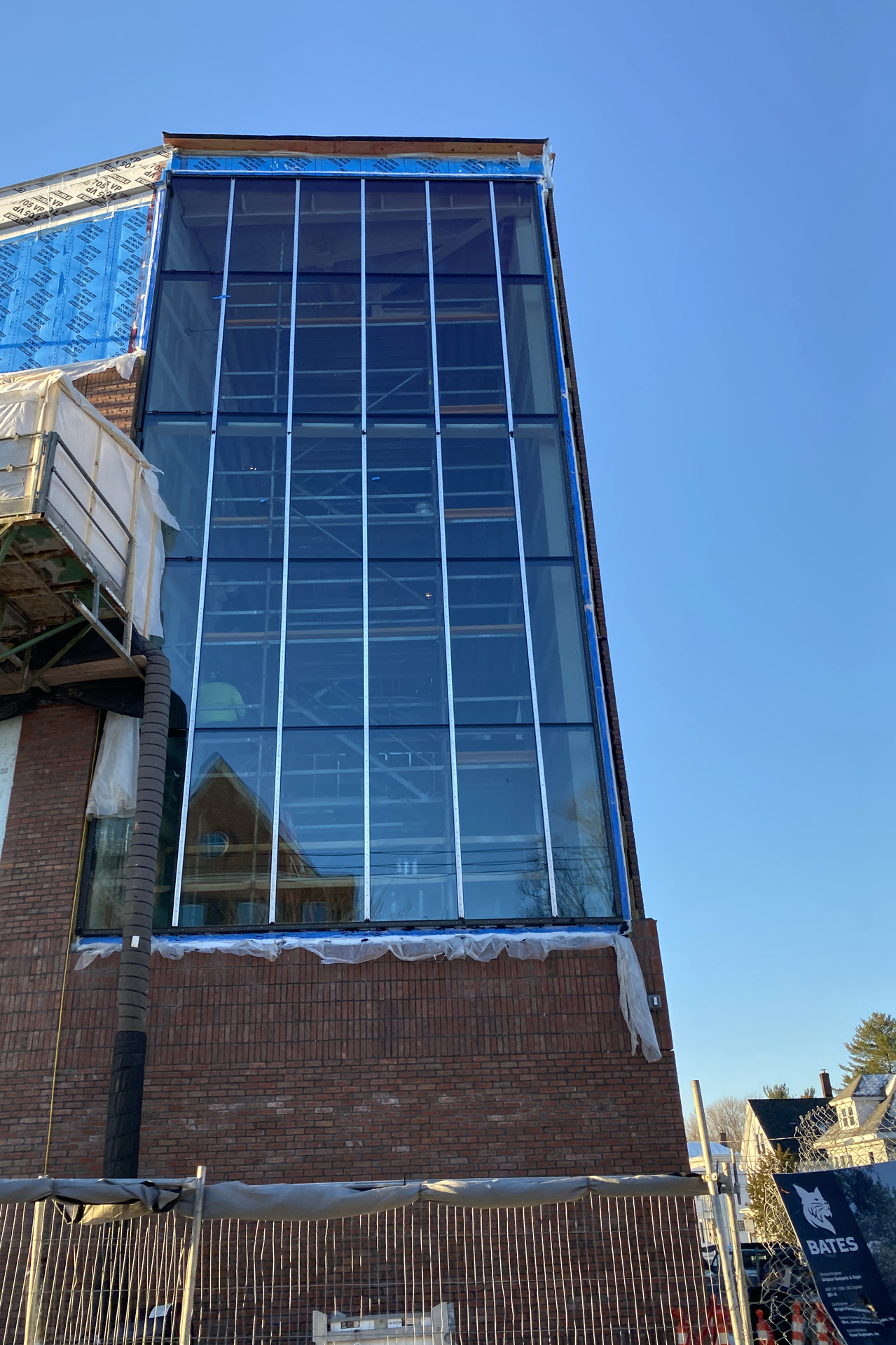 This Jan. 8 view shows a signature Bonney Center feature, the Beacon, with its glass curtain wall complete. (Geoff Swift/Bates College)