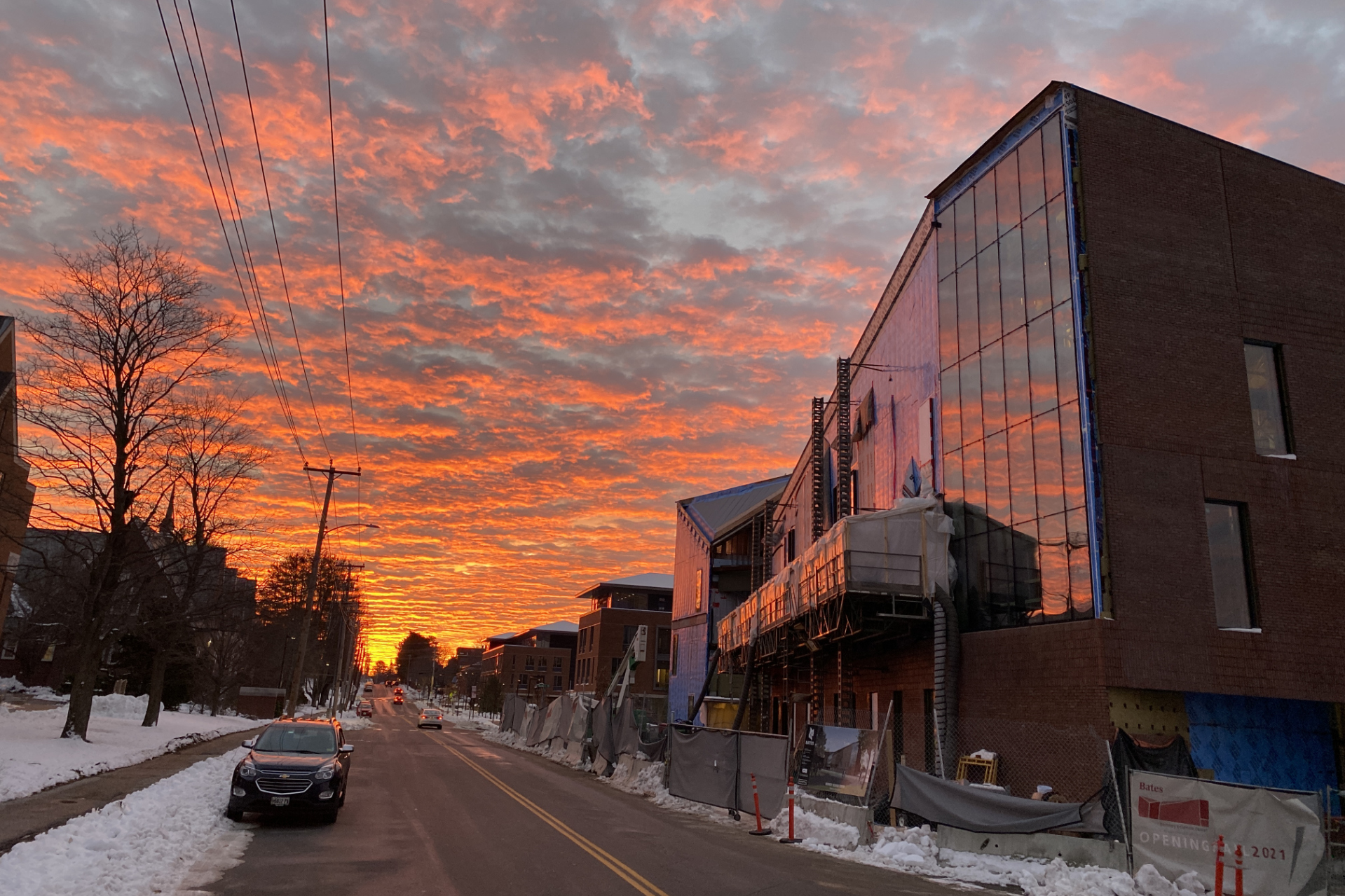 An otherworldly sunrise illuminates Campus Avenue and the Bonney Science Center on Dec. 11. (Geoff Swift/Bates College)