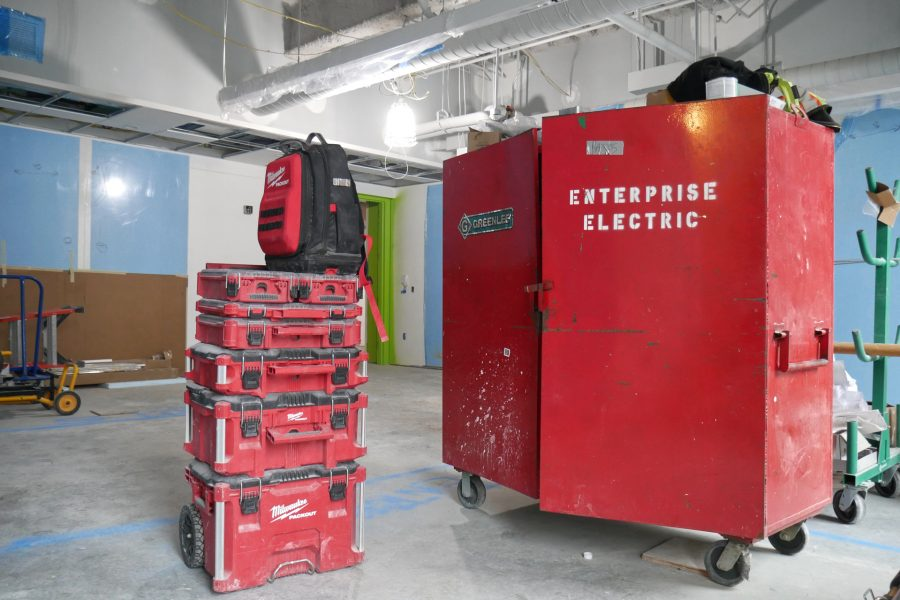 """Known as """"gang boxes,"""" rolling cabinets like the one at right serve as portable offices for subcontractors. A first-floor Bonney Center classroom houses this Enterprise Electric gear. (Doug Hubley/Bates College)"""