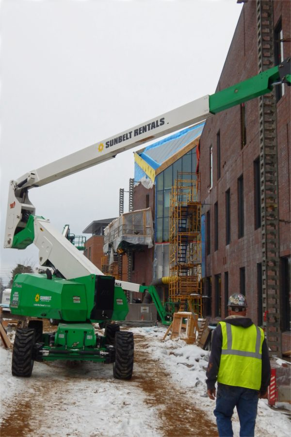 """A view along the north wall of the Bonney building on Feb. 15. The """"notch,"""" aka the building's main entrance and adjacent glass wall, appears at center. (Doug Hubley/Bates College)"""