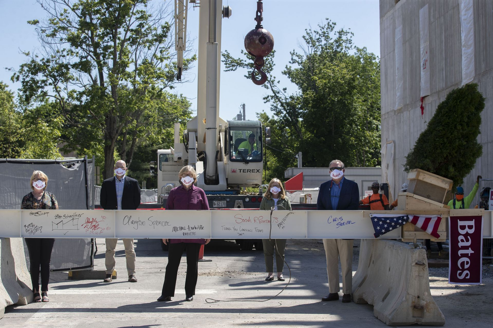 Images from the topping off event on May 16, 2020, at the Bonney Science Center, featuring the final major piece of structural steel being installed on the building. In keeping with tradition, a small spruce tree was attached to the beam fluttered plus a Bates banner and the American flag. The beam has the signatures of Bates participants and members of the Consigli construction crew.  Participants: Michael W. Bonney '80, P'09, P'12, P'15 Alison Grott Bonney '80, P'09, P'12, P'15 Sarah R. Pearson '75, Vice President for College Advancement A. Clayton Spencer, President Chris Streifel, Facilities Services Project Manager Geoff Swift, Vice President for Finance and Administration and Treasurer Pam Wichroski, Director of Capital Planning and Construction Dave Thomas, Consigli Construction  Michael Hinchcliffe, Payette Architecture Firm  Bob Schaeffner, Payette Architecture Firm