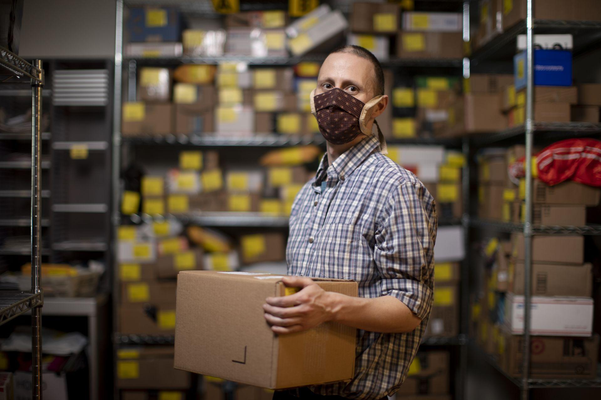Robert Bosse holds package in Post &Print.