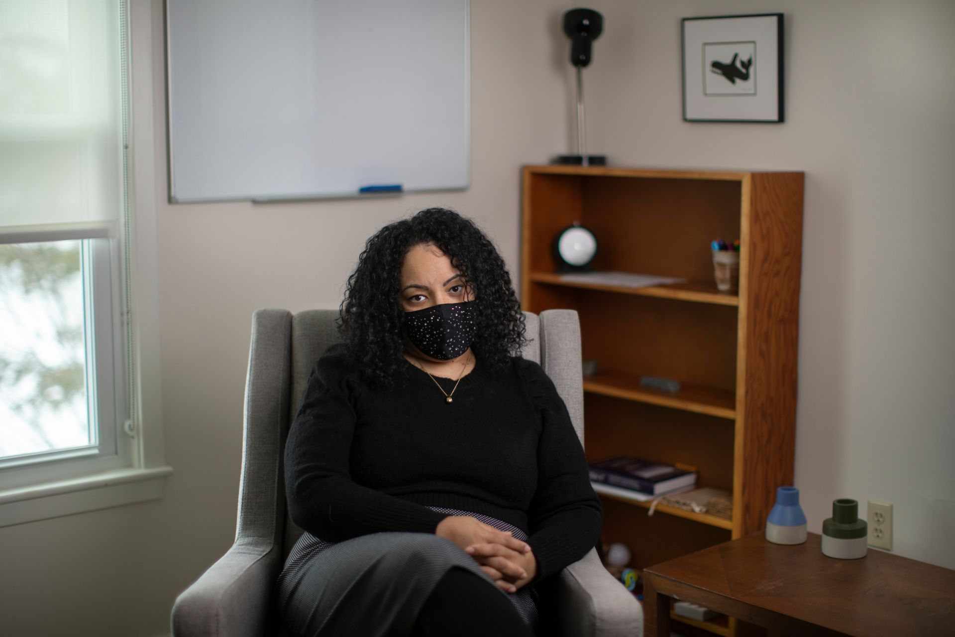 A psychological counselor sits in her office.