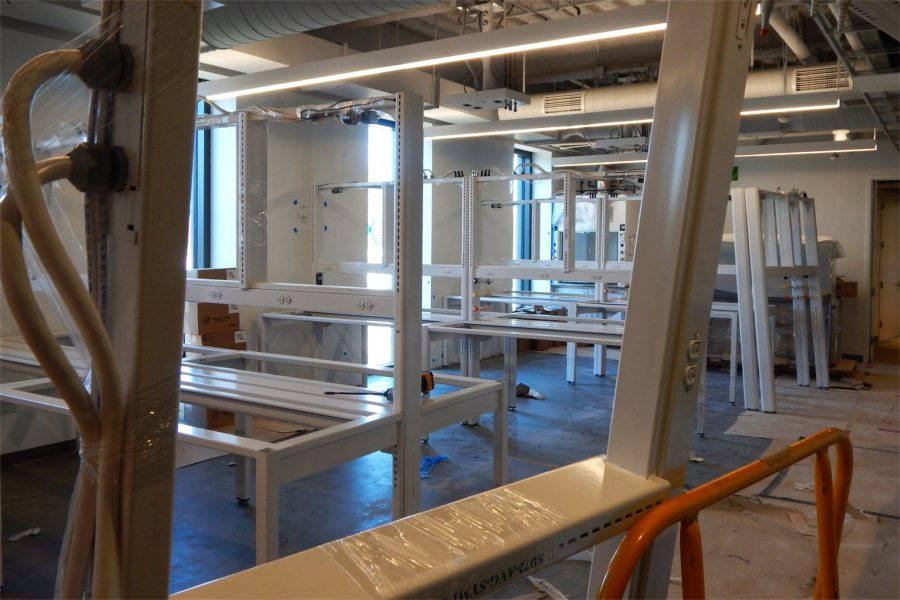 Lab benches being assembled in a third-story room. (Doug Hubley/Bates College)