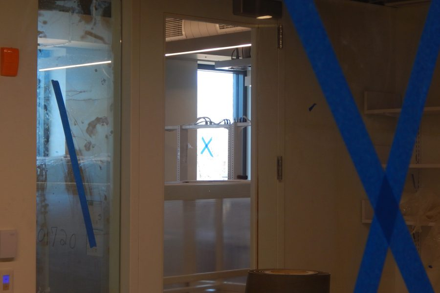 As a safety measure, glass is marked with blue tape for visibility. (Doug Hubley/Bates Coilege)
