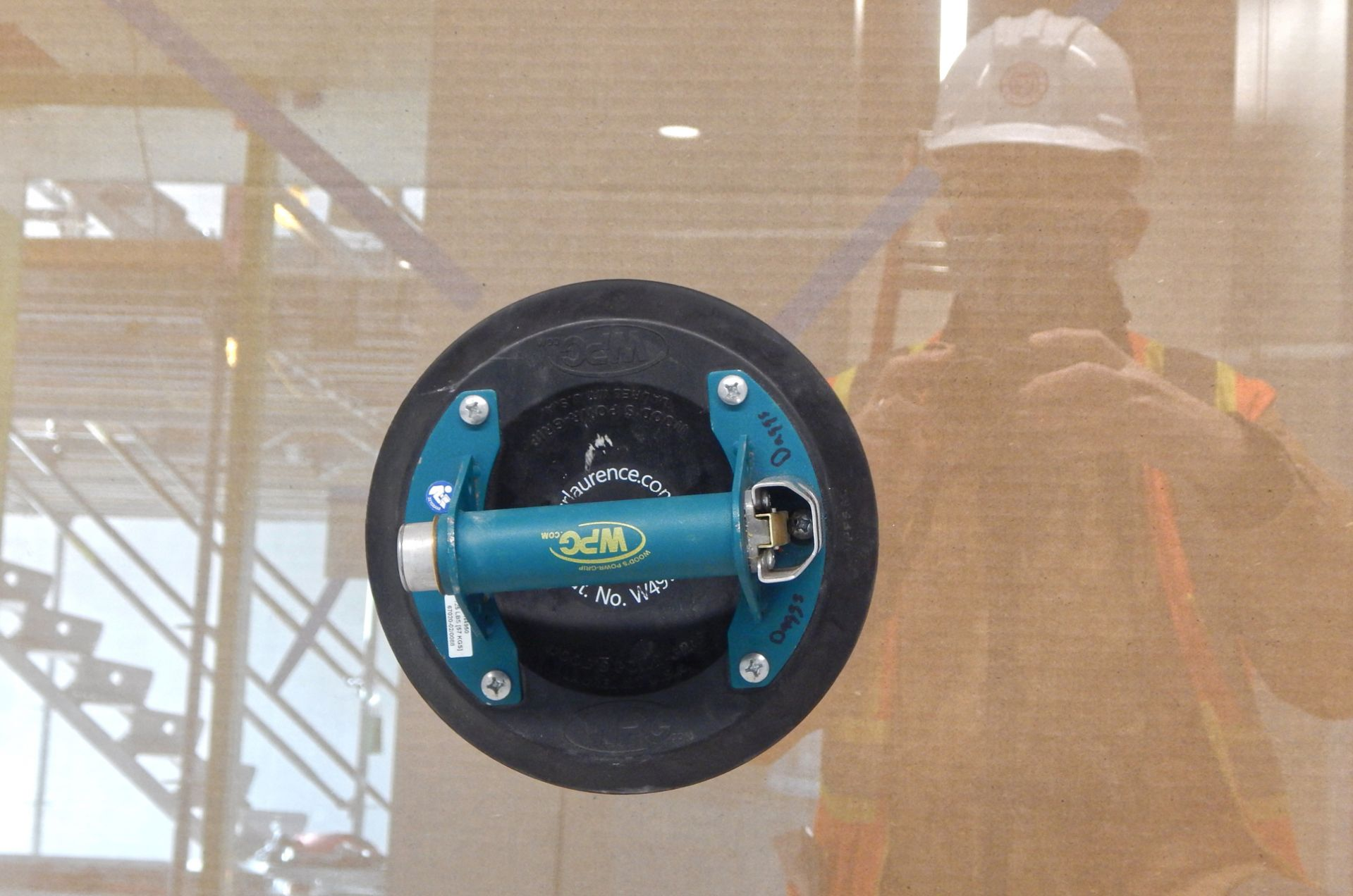 The disc-shaped object is a suction-cup used to handle panes of glass. The glass it's stuck to will be set in a door. (Doug Hubley/Bates College)