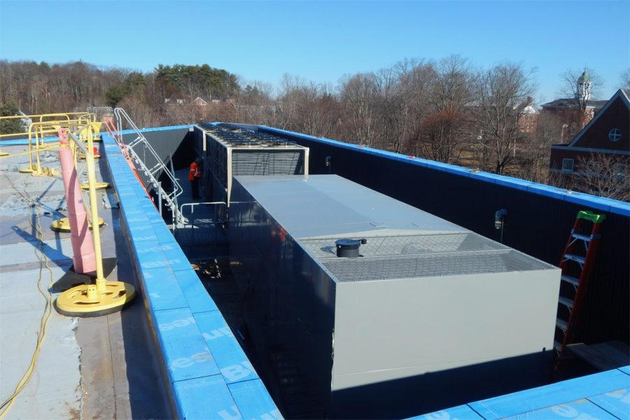 This rooftop view shows the Bonney Center's mechanical well, enclosing an emergency electrical generator and, at rear, a water chiller that will help control air temperatures within the building. (Doug Hubley/Bates College)