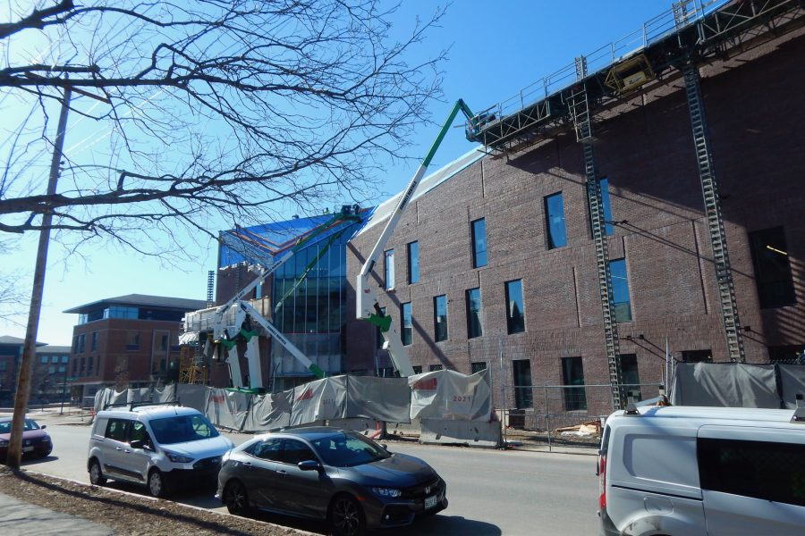 Shown on March 22, lifts bring workers and materials to spots on the Bonney Center's north side where masonry and roofing work is still in progress. (Doug Hubley/Bates College)