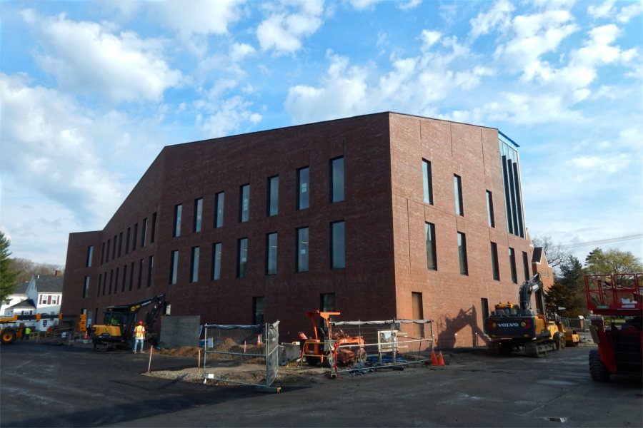 The south and east sides of the Bonney Science Center on April 21. Note the base coat of new paving behind the building. (Doug Hubley/Bates College)