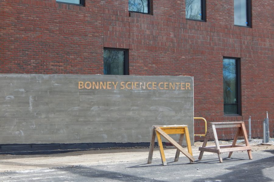 Proclaiming the name: Placed earlier this month, a concrete wall near the Bardwell Street entrance to the construction site is the first instance of the Bonney Center's name appearing on the building itself. (Doug Hubley/Bates College)