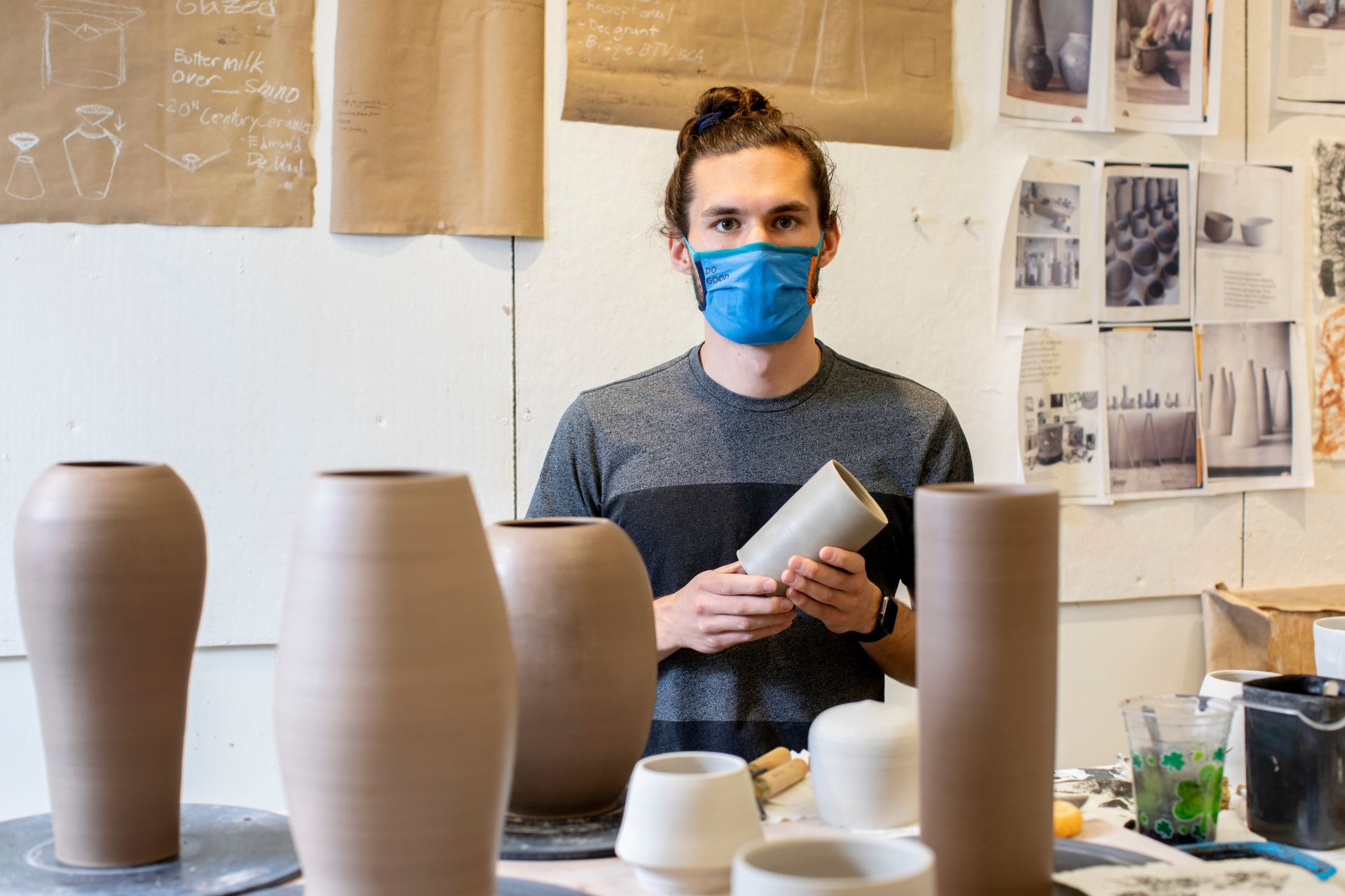 Christopher Barker '21 of Burlington, Vt., poses and works in his Olin Arts Studio Room 132. His ceramics will be on display in the annual senior exhibition in the Bates Museum of Art.