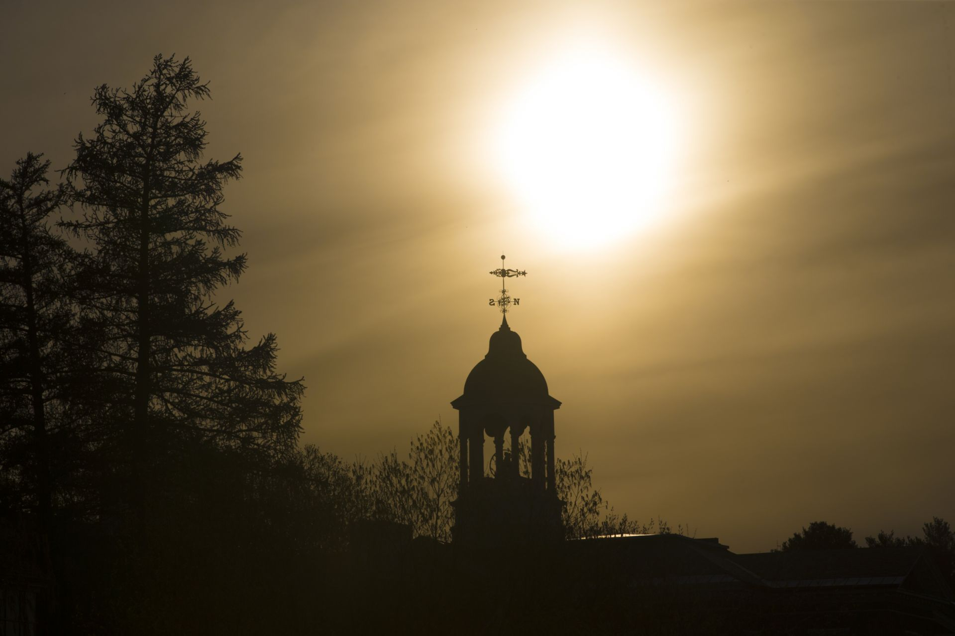 Sun sets behind Hathorn Hall.