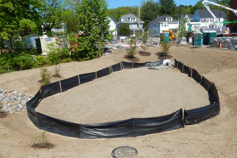The freshly contoured runoff basin at the back of the Bonney Center lot. Storm runoff will be routed through the basin to slow surges of water into the municipal stormwater system. (Doug Hubley/Bates College)