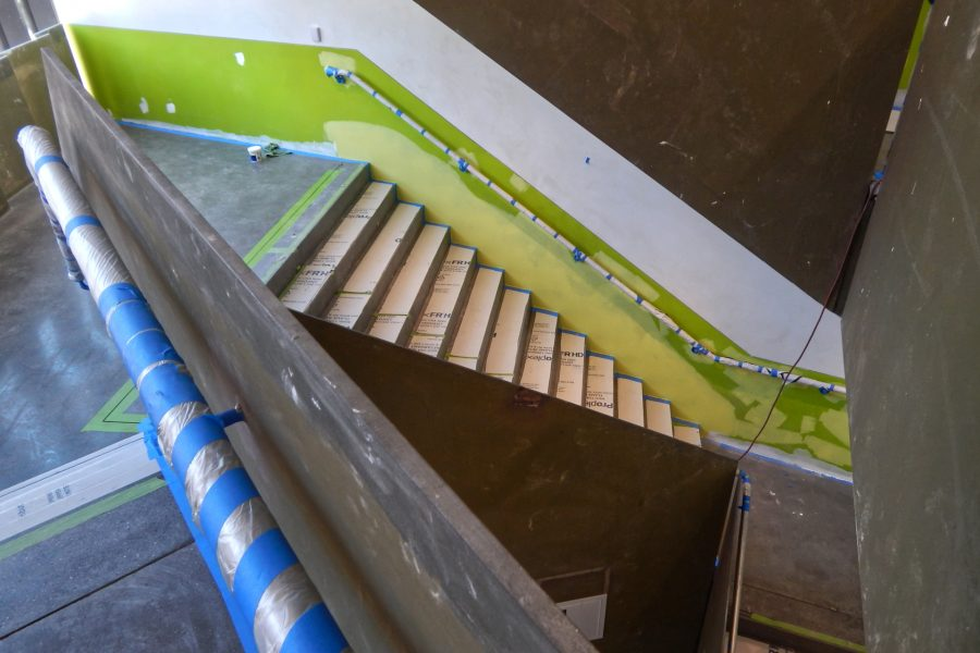 Painting in progress and polished (but dusty) concrete in the Monumental Stair. (Doug Hubley/Bates College)
