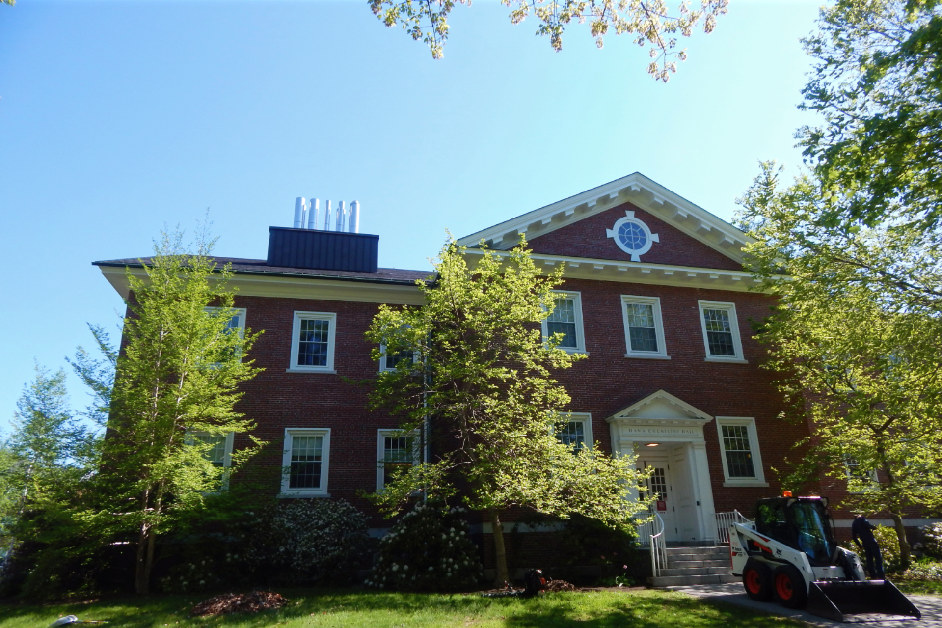 A May 17 view of Dana Chemistry Hall is punctuated by bright new foliage. (Doug Hubley/Bates College)