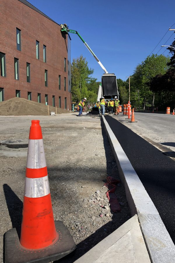 Site subcontractor Gendron & Gendron sets curbing along the Bonney Science Center's Campus Avenue frontage. (Jay Burns/Bates College)