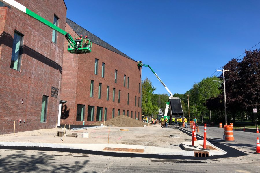 Exterior sitework at Bonney Science Center along Campus Avenue, including contractor Gendron & Gendron setting curbs at the entrance plaza that will be paved with asphalt blocks. (Jay Burns/Bates College)