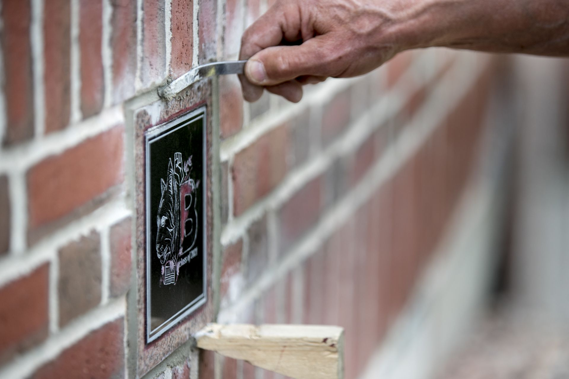 Muskan VermaÊ'21 of Shimla, India, designed the Class of 2021 Ivy Stone that Bates mason Ron Tardif installed to the right of the front door entrance to Pettengill Hall.