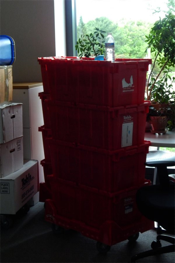 Totes and cartons awaiting unpacking by a member of the chemistry faculty. (Doug Hubley/Bates College)