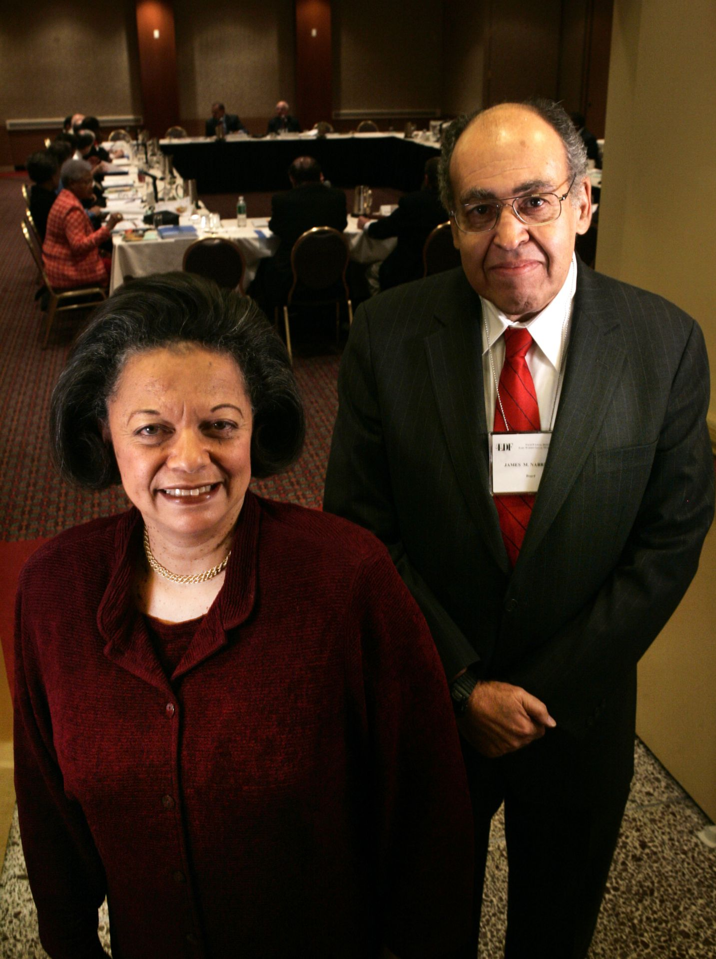 New York City, 9:47 a.m. , Nov. 3, 2005  DUAL OF LAW At a Manhattan hotel, NAACP Legal Defense Fund board secretary James M. Nabrit III '52 and fellow board member Karen Hastie Williams '66 take a quick break from the group's annual meeting. Nabrit is a former LDF litigator who argued numerous important civil rights cases before the U.S. Supreme Court; Williams is a retired partner in the Washington law firm of Crowell & Moring LLP.  Photo by Michael Appleton for Bates College  From the Winter 2006 issue of Bates Magazine photo essay capturing Bates people around the world photographed at the same moment on the same day: 9:47 a.m. Eastern Time (or 14:47 Greenwich Mean Time, if you wish) on Nov. 3, 2005.