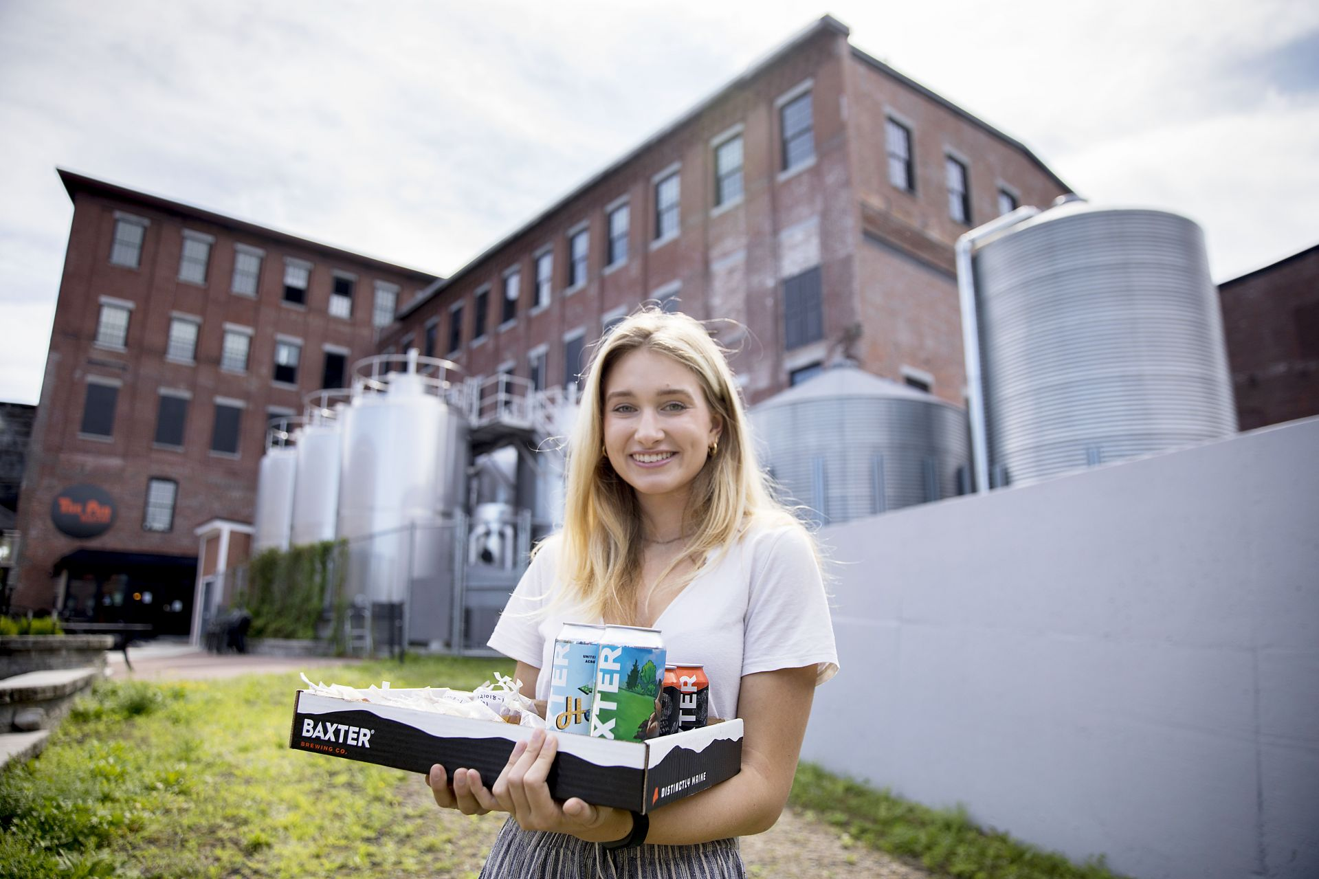 Emily Tamkin '22, a biology major from Lafayette, Calif., is doing a summer '21 purposeful work internship tin brewing science, partnering with the Baxter Brewing Co. in Lewiston, where she's studying the number of battering compounds that exist in beer throughout the brewing process. She is working under the supervision of Merritt Waldron, Baxter's quality control manager, and Assistant Professor of Biology Lori Banks.  Emily picks up samples from Baxter's plant at 130 Mill Street in Lewiston and takes them to Carnegie Science where, in Dr. Bank's lab, she conducts a chemical analysis of them. The compounds hit your taste buds, and your brain understands that they are bitter, she says.