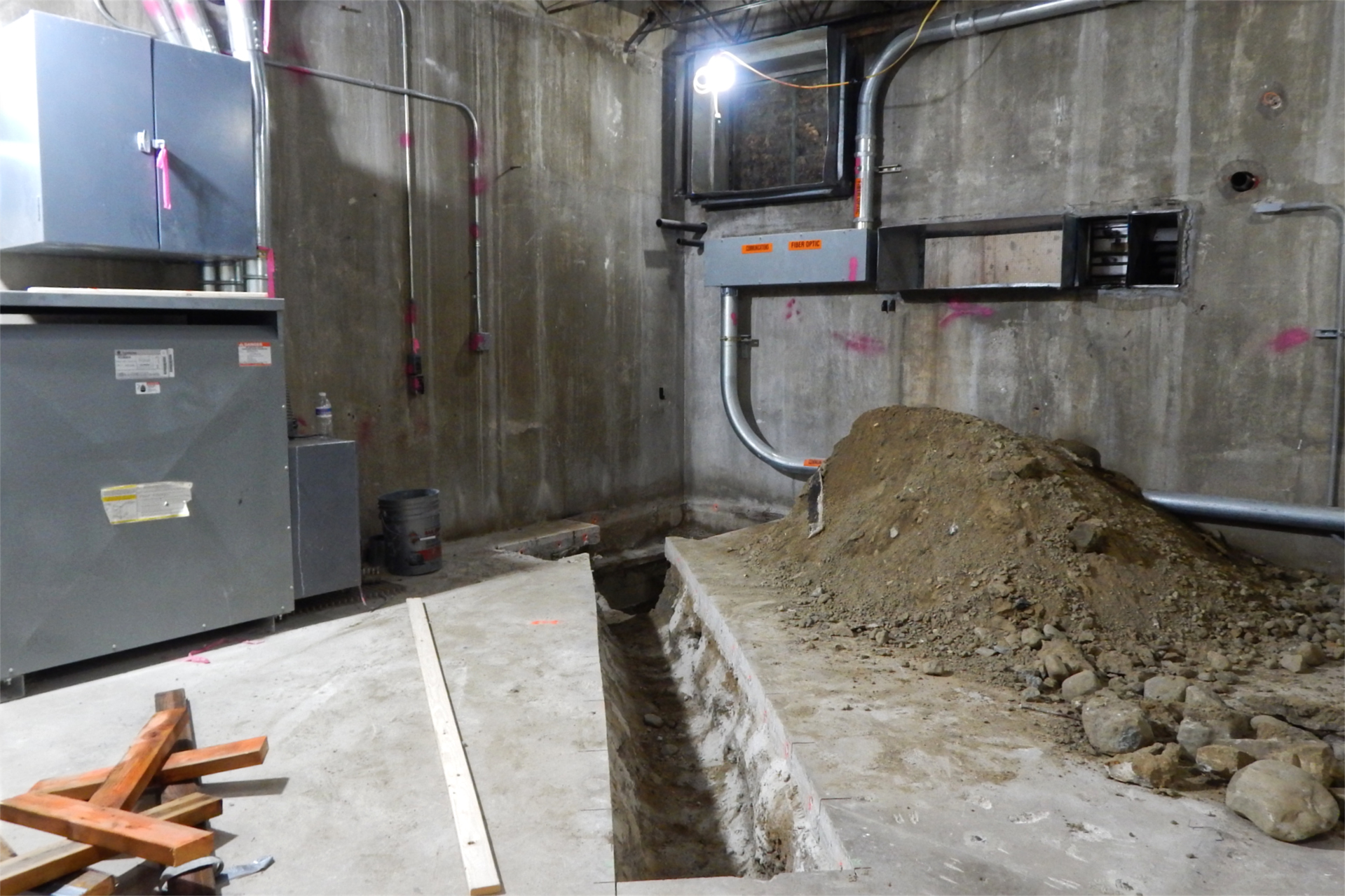 A new trench for floor drain infrastructure in the basement of Dana Chemistry. (Doug Hubley/Bates College)