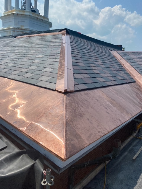 New slate roofing and copper flashing atop Hathorn Hall. (Robert Leavitt/Bates College)