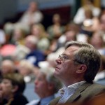 A sea of attendees listens closely to President Hansen's opening address in the Olin Arts Center Concert Hall.