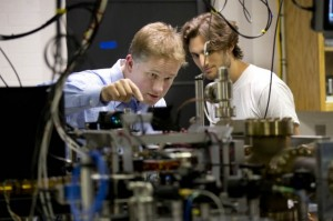 Physics major Ben Lovitz '15 of Portland, Ore., works with his adviser, assistant professor Nathan Lundblad in his ultra-cold atomic physics lab. Lovitz is one of four senior physics majors who won competitive research fellowships last summer. (Phyllis Graber Jensen/Bates College)