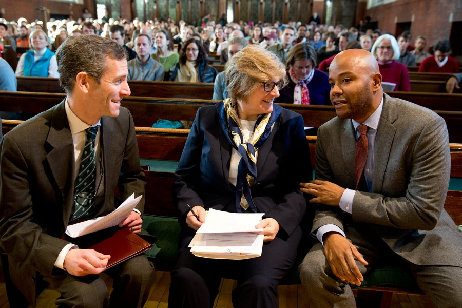 President Clayton Spencer and Matt Auer, dean of the faculty and vice president for academic affairs (left), talk with author and historian Peniel Joseph prior to his 2015 MLK Day keynote address at Bates. (Phyllis Graber Jensen/Bates College)