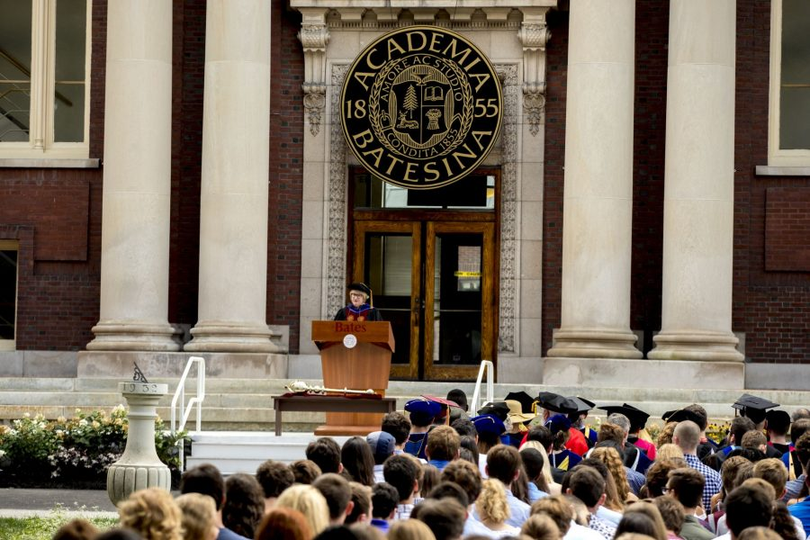 """Convocation, held at 11 a.m. today on the Historic Quad, """"provided Bates with an opportunity to welcome the Class of 2022, to celebrate the opening of the college, and to consider, as a community, our shared goals and hopes for the academic year,"""" said President Clayton Spencer. . Led by the College Mace Bearer Michael Murray, Phillips Processor of Economics, the Convocation procession included President Spencer, Student Body President Walter Washington '19 of Fleetwood, N.Y., and Associate Professor of History Joe Hall. . According to Spencer, """"the College has resuscitated what was once a Convocation tradition at Bates: asking the outgoing senior class to select a faculty speaker for the incoming freshman class."""" In this case, the Class of 2018 chose Hall to address the Class of 2022 -- and the entire Bates community. His talk was titled, """"Questions for Bates."""" . Immediately following Convocation, members of the Bates community attended a brief tree-planting ceremony, on the Quad behind Carnegie Science, held in memory of those in the Bates community who died during the past year. The ceremony was followed by a lunch will be served on the Library Quad for the college community."""