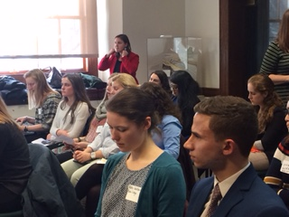 Bates, Bowdoin and Colby students listen to a panel presentation during the Public Policy Roadshow at the Maine State House.