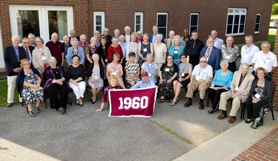 Members of the Class of 1960  pose for a class picture in front of the Benjamin Mays Center.