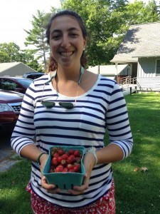 Sophie with some fresh Maine strawberries