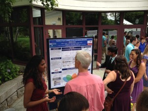 Students present their poster findings to Dr. Bob Morris from Wheaton College