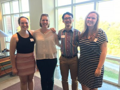 Alex, Larissa, Quang, and Maddie at the poster presentation